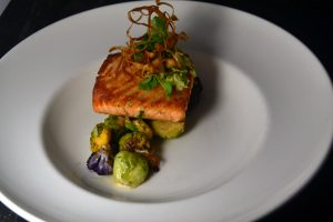 Cape d'Or Salmon with Horseradish Crema, Brussels Sprouts, Crispy Salsify at 1700 Degrees Steakhouse in Harrisburg PA